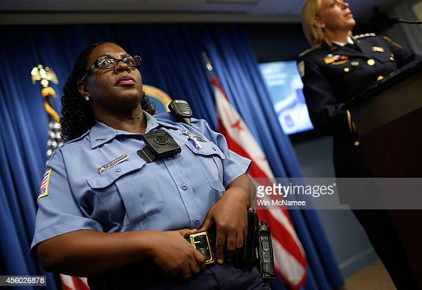Washington DC Metropolitan Police Officers Debra Domino wears one of the new 'bodyworn cameras' that the city's officers will begin using during a...