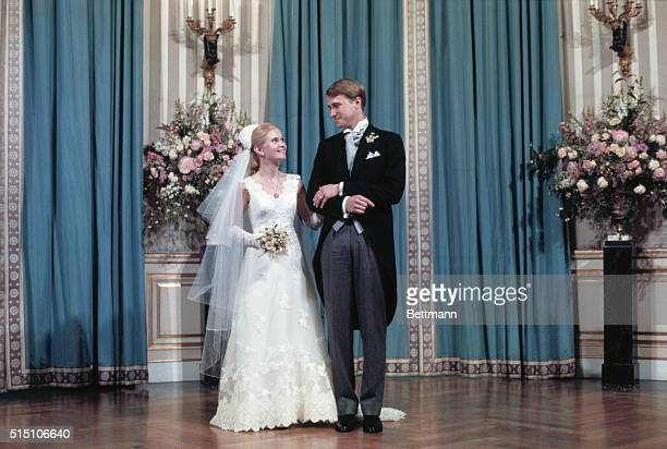 Mr and Mrs Edward Finch Cox pose for a formal photograph in the White House following their wedding in the White House rose garden The bride nee...