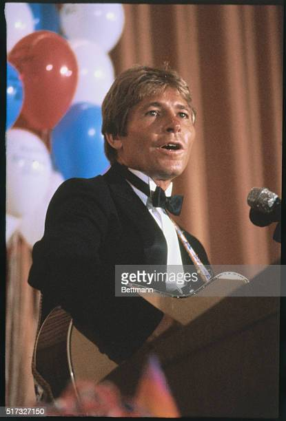 Musician John Denver sings at the birthday roast for Democratic Congressman Morris Udall from Arizona