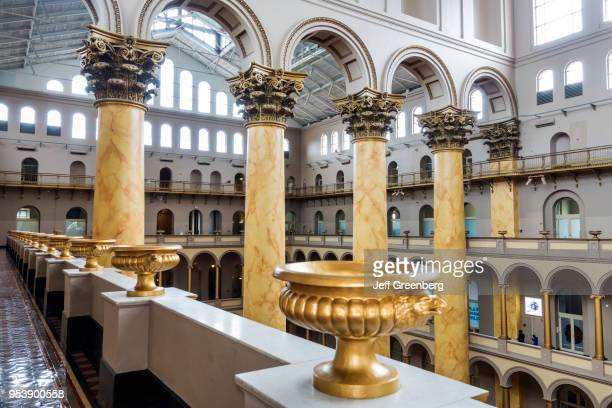 Washington DC, National Building Museum, Pension Building, Great Hall, with Corinthian columns and gilded urns.