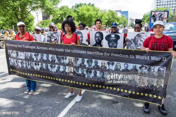 Washington DC, National Memorial Day Parade, youth volunteers with banner for Tuskegee Airmen, World War II.