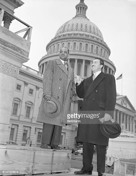 1/6/1949 Washington DC Negro Congressmen Representative William Dawson and Representative Adam Clayton Powell Negro congressmen pause to look at...