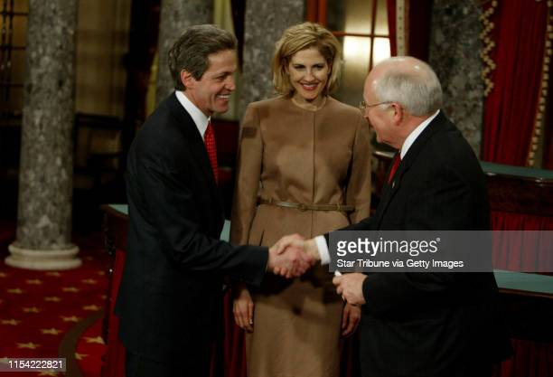 Washington DC Norm Coleman sworn in as US Senator Minnesota Senator Norm Coleman with his wife Laurie at his side shakes hands with Vice President...