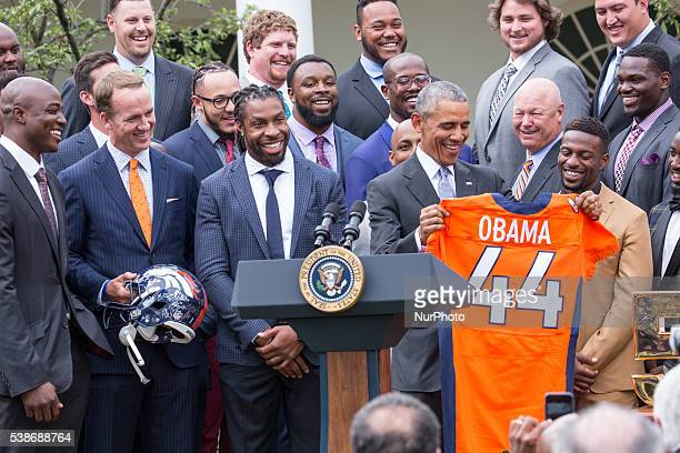Washington DC On Monday June 6 in the Rose Garden of the White House President Barack Obama holds up a Denver Broncos jersey presented to him as a...