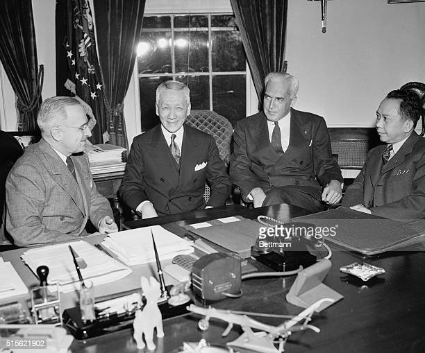 Philippine President Calls On Truman Shown during a visit with President Truman at the White House are left to right President Truman President...