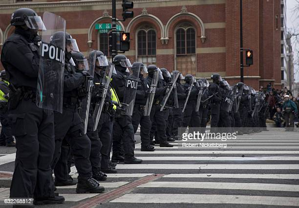 Washington, DC policemen confront anti-Trump protesters after the inauguration ceremony January 20, 2017 in Washington, DC. Protestors and supporters...