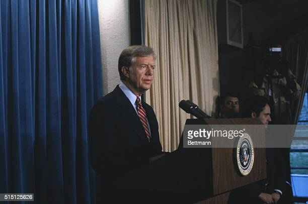President Carter announces at the White House April 7 that he has broken diplomatic relations with the government of Iran because of the 'illegal and...