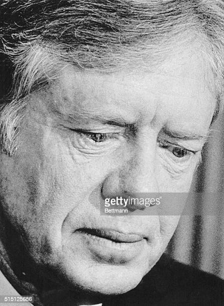 President Carter expressed deep regret at the death of eight American crewmen in the crash of two US aircraft on a remote desert in Iran during...