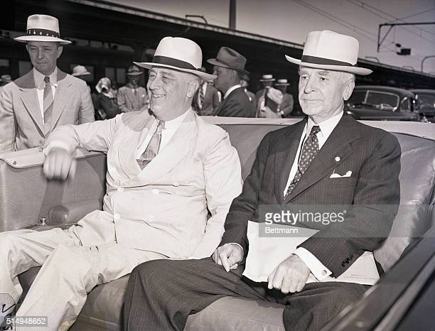 Washington, DC: President Franklin D. Roosevelt is met by United States Secretary of State Cordell Hull upon his arrival back in Washington, DC.