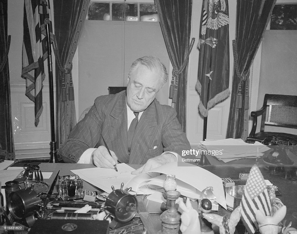President Franklin Roosevelt Signing Document : News Photo