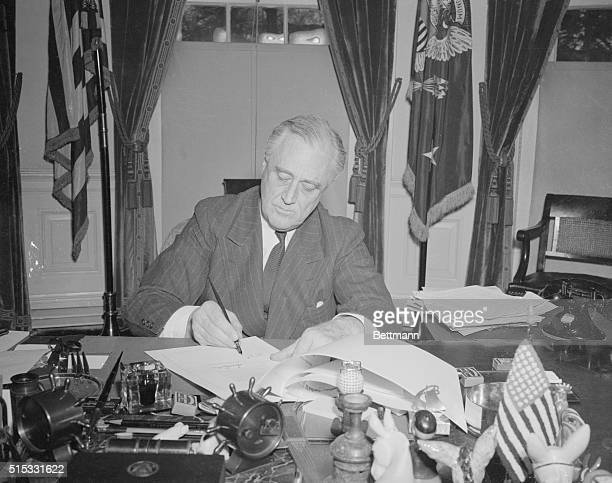 President Franklin D Roosevelt is shown signing the historic LendLease Bill at the White House in Washington DC He put it into immediate effect by...