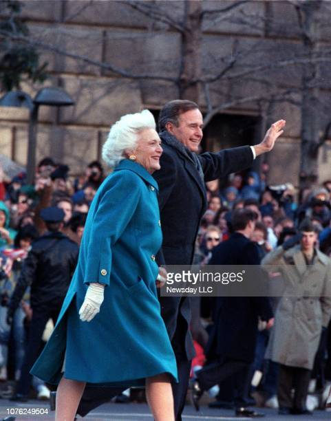 President George H.W. Bush waves to the crowd and walks with wife Barbara Bush on Inauguration Day in Washington, D.C. On January 20, 1989.