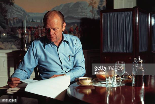 Washington, D.C.: President Gerald Ford eats breakfast he fixed for himself in the small kitchen of the living quarters in the White House. He goes...