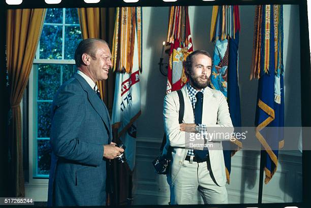 President Gerald Ford introduces his personal photographer David Hume Kennerly at the White House August 11th The president is holding Kennerly's...