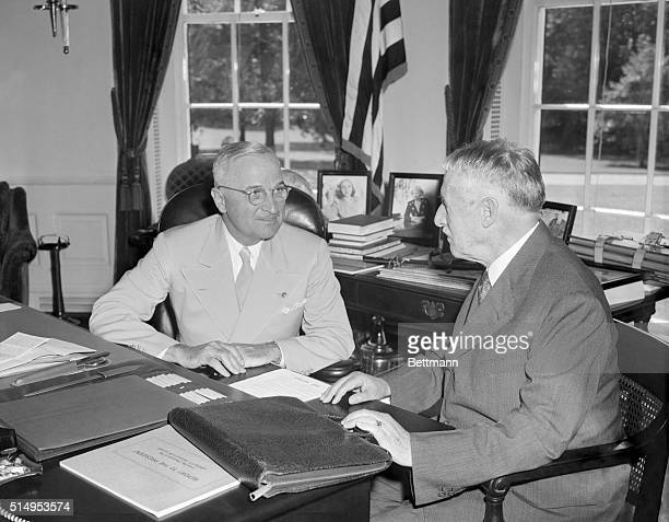 Washington, DC- President Harry Truman gets a report on the bombing of Japan from Secretary of War Henry Stimson, President Truman upon his return...