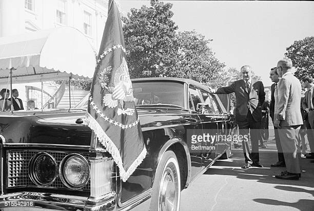 President Johnson inspects the new presidential limousine a 21foot custombuilt Lincoln Continental that was delivered to the Secret Service at the...