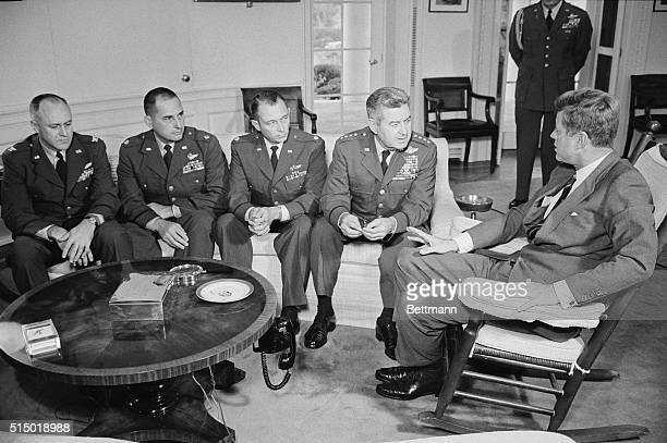 President Kennedy met with and commended two Air Force pilots who have been flying reconna issuance missions over Cuba and the Pentagon officer in...