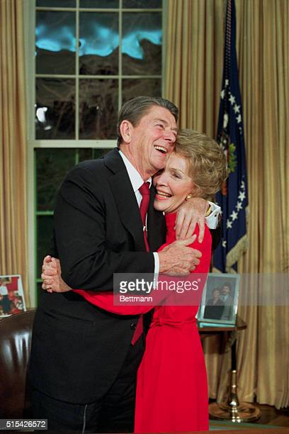 President Reagan hugs his wife Nancy in the Oval Office late after announcing on national television that he will seek reelection