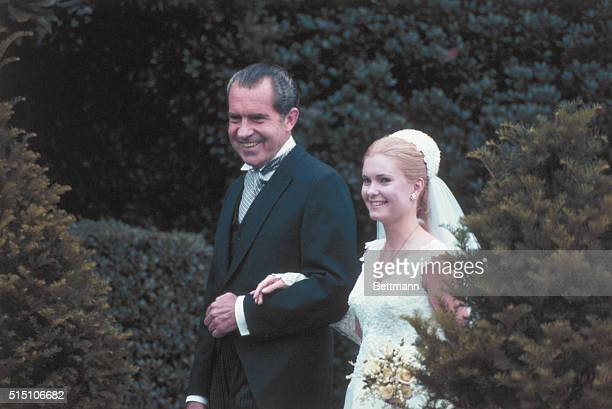 President Richard M Nixon escorts his daughter Tricia from the White House to the rose garden for her marriage to Edward Finch Cox June 12th