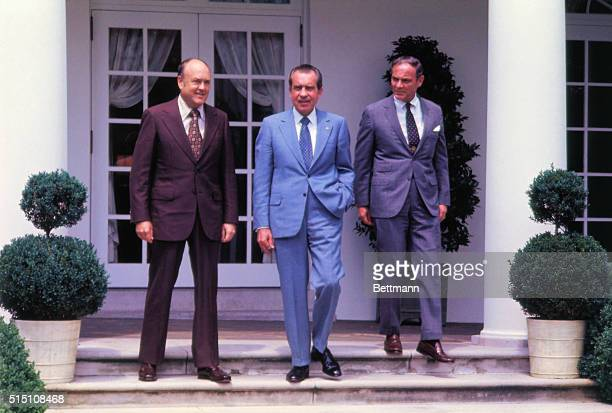 Washington DC President Richard Nixon in the White House Garden with Melvin Laird L and General Alexander Haig after announcing Laird will become...