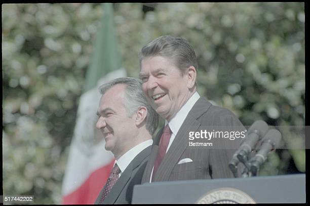 President Ronald Reagan and President Miguel De La Madrid of Mexico attend arrival ceremonies 5/15 on the South Lawn during President De La Madrid's...