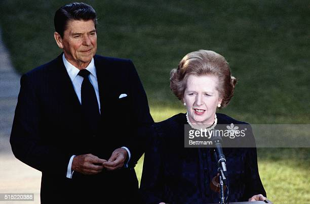 6/23/1982 Washington DC President Ronald Reagan with Margaret Thatcher depart from the Oval Office