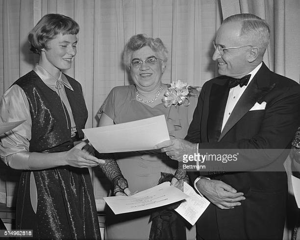 President Truman is shown presenting an award naming her as one of the Women of the Year to Ingrid Bergman for her performance in Joan of Lorraine Dr...