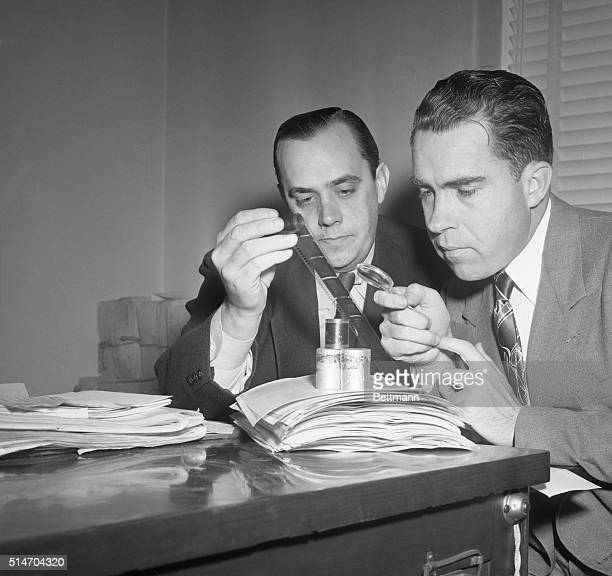 12/6/1948 Washington DC Representative Nixon looks over microfilm in spy case Rep Nixon right member of the House UnAmerican Activities Committee who...