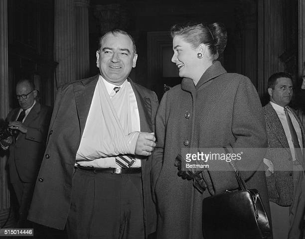Washington, D.C.: Senator and Mrs. Joseph R. McCarthy are shown outside the Senate chamber shortly before the Senate adopted today a two-count...