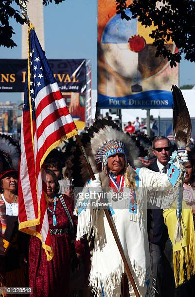 Washington DC Sept 21 2004 <cq><cq> Senator Ben Nighthorse Campbell<cq> carries the US flag as he leads the Native Nations Procession to start the...
