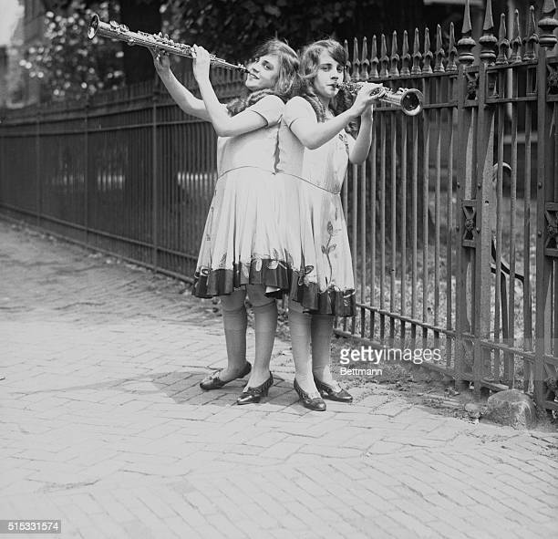 Siamese Twins serenading British Embassy The above photo showsViolet and Daisy Hilton Siamese twins of San Antonio Texas as they serenaded officials...