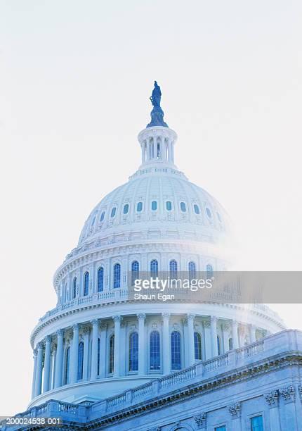usa, washington dc, sun shining behind the capitol, close-up - capitol building washington dc stock pictures, royalty-free photos & images