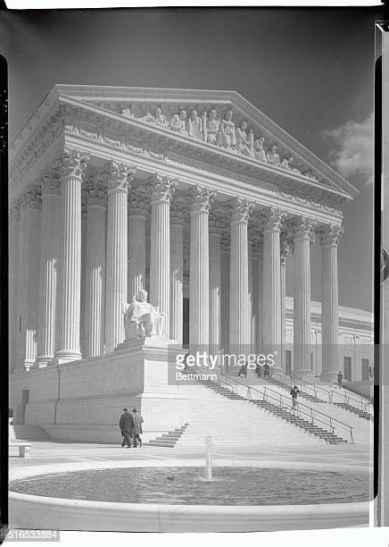The exterior of the US Supreme Court Building There is a fountain in the foreground of the photograph Undated photograph
