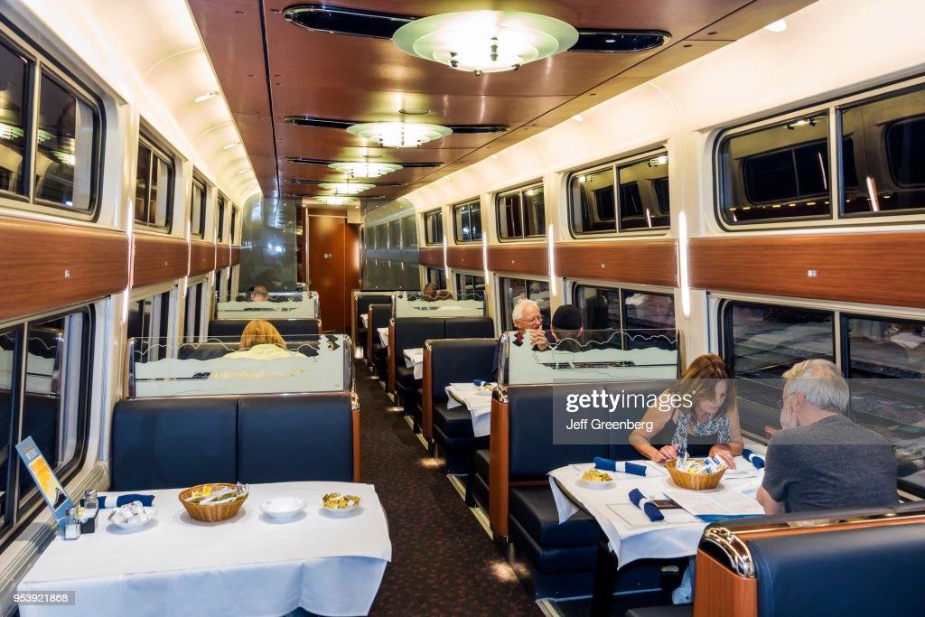 Washington DC, Union Station, Amtrak, Couple eating in dining car : News Photo