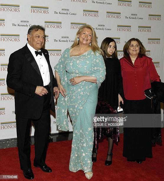 Conductor Zubin Mehta one of this year's Kennedy Center honorees arrives with from left his wife Nancy Shenaya Chinoy and Zarina Mehta at the State...