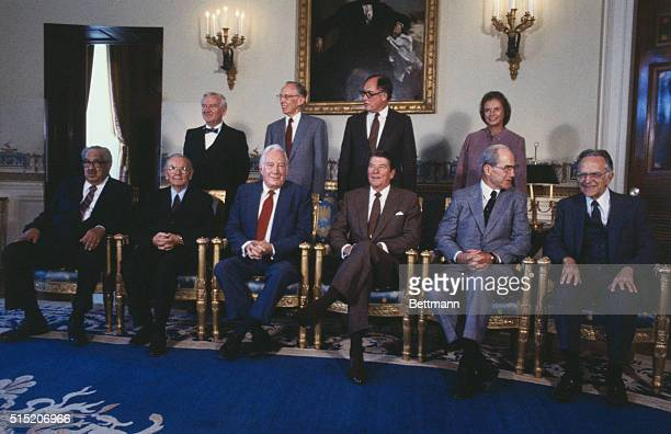 United States President Ronald Reagan poses for a formal portrait with the judges of the United States Supreme Court From left to right are John Paul...