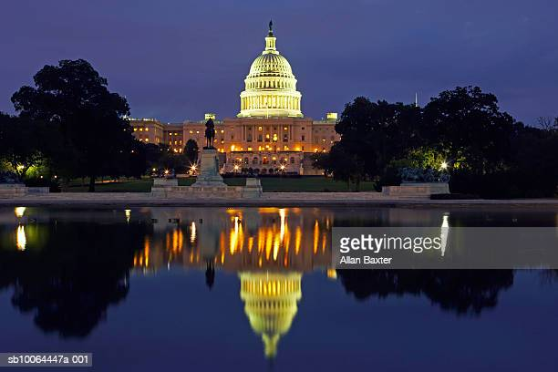 USA, Washington DC, US Capitol building reflected in pool, night