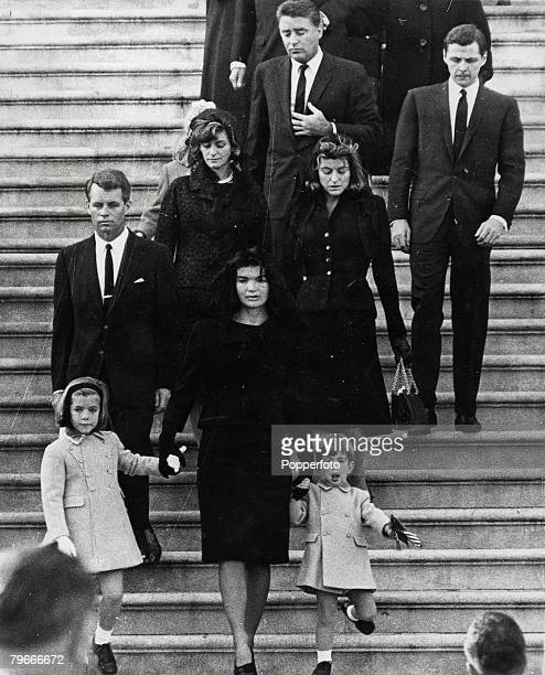 Washington DC USA 24th November A grieving Jacqueline Kennedy holds the hand of her son John F Kennedy Junior and daughter Caroline as they walk down...