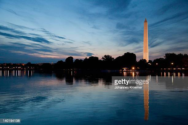 usa, washington dc, washington monument reflecting in water at dusk - national monument stock pictures, royalty-free photos & images