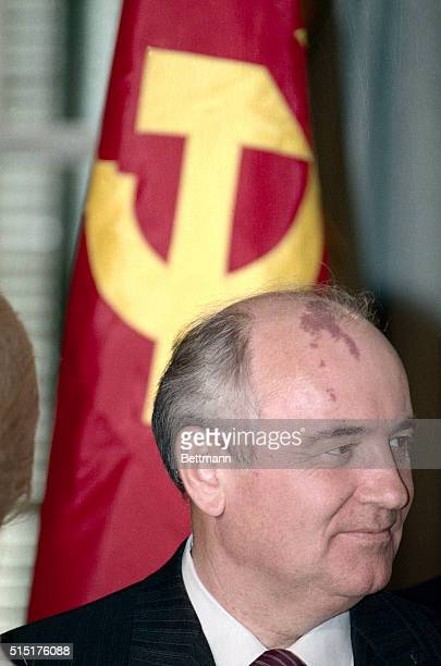 Washington, DC- With a soviet flag behind him, Soviet General Secretary Mikhail Gorbachev pays a call at the State Department 12/9. BPA2#5815.