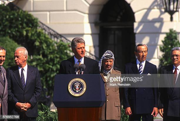Washington DC9131993 Shimon Peres Israel's foreign minister signs the Oslo Peace Accords as LR Russian Foreign Minister Andrei Vladimirovich Kozyrev...