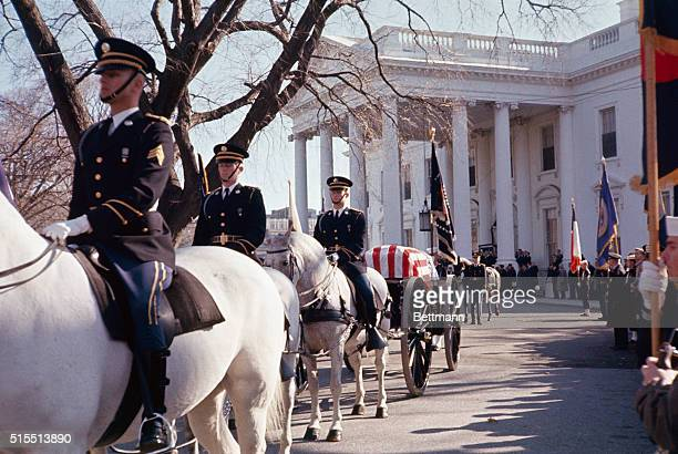 Caisson waiting at White House as procession is organized or solemn rites at St Matthew's Cathedral for John F Kennedy Cathedral
