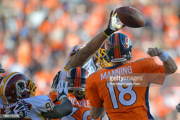 Washington defensive end Stephen Bowen center has his hand on the fumble from Denver quarterback Peyton Manning leading to a recovery by Washington...