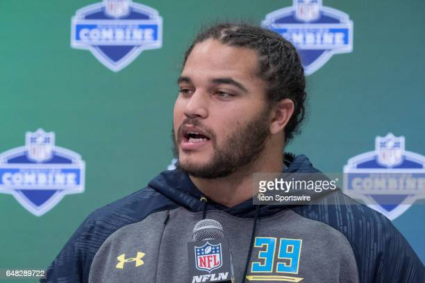 Washington defensive tackle Elijah Qualls answers questions from members of the media during the NFL Scouting Combine on March 4 2017 at Lucas Oil...