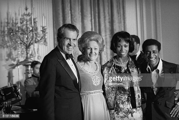 Entertainer Sammy Davis Jr acknowledges ovation following his performance at a White House gala It was the first of Nixon's socalled evenings of...