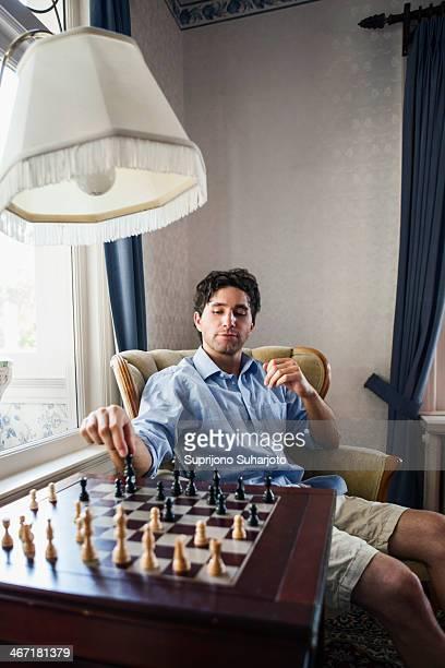 USA, Washington, Everett, Portrait of young man playing chess