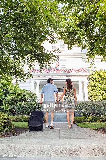 USA, Washington, Everett, Rear view of couple walking towards hotel