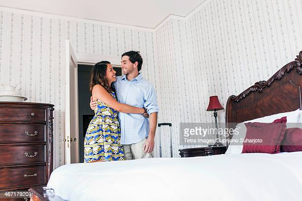 USA, Washington, Everett, Young couple embracing in hotel room