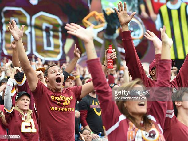Washington fan Isaac Minor celebrates during the third quarter at FedEx field on October 25 2015 in Landover MD