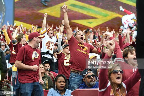 Washington fans Brian Rose and Isaac Minor celebrate during the third quarter at FedEx field on October 25 2015 in Landover MD